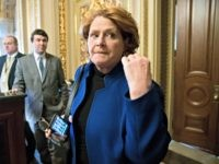 In this Jan. 22, 2018 file photo, Sen. Heidi Heitkamp, D-N.D., leaves a meeting with fellow Democrats at the Capitol in Washington. In places like Boston and Los Angeles, Democrats are blasting the new tax law as a boon to the rich and a corporate giveaway. In North Dakota, Sen. …