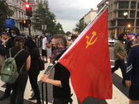 Communist flag displayed at counter-protest to Unite the Right demonstration in DC on the one year anniversary of Charlottesville protests (Credit: Matthew Perdie/Breitbart News)