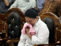 Meiliana wept as her sentence was read out at a district court in Medan, North Sumatra, Indonesia (AP)