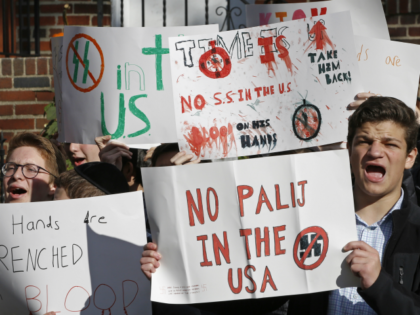 High school students from the Orthodox Jewish Rambam Mesivta school protest across the street from the home of Jakiw Palij, 94. a former Nazi concentration camp guard whose citizenship has been revoked, but hasn't been deported, Thursday, Nov. 9, 2017, in the Jackson Heights neighborhood of New York. Palij was …