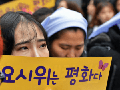"""Protesters demonstrate near a statue of a South Korean """"comfort women"""" during a protest in front of the Japanese Embassy in Seoul last year. Japan has previously expressed concern regarding the memorialization of the women forced to serve in Japanese wartime brothels. File Photo by Keizo Mori/UPI"""