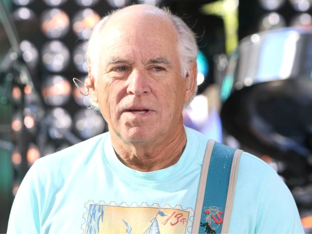 """Jimmy Buffett performs on NBC's """"Today"""" show on Thursday, Aug. 15, 2013 in New York. (Photo by Greg Allen/Invision/AP)"""