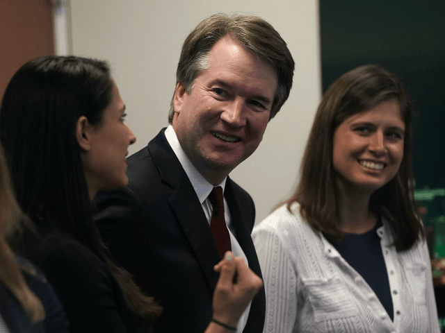 Supreme Court nominee Judge Brett Kavanaugh (2nd R) waits for a meeting with U.S. Sen. Dean Heller (R-NV) on Capitol Hill July 18, 2018 in Washington, DC. Kavanaugh is meeting with members of the Senate after U.S. President Donald Trump nominated him to succeed retiring Supreme Court Associate Justice Anthony …