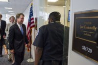 Supreme Court nominee Brett Kavanaugh walks to the office of Sen. Joe Donnelly, D-Ind., for a meeting on Capitol Hill in Washington, Wednesday, Aug. 15, 2018.