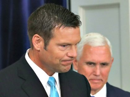 WASHINGTON, DC - JULY 19: Kansas Secretary of State, Kris Kobach (L) and US Vice President Mike Pence, attend the first meeting of the Presidential Advisory Commission on Election Integrity in the Eisenhower Executive Office Building, on July 19, 2017 in Washington, DC.