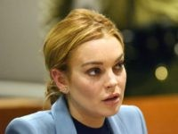 Lindsay Lohan attends her probation hearing with attorney Shawn Chapman Holley (not pictured) at the Airport Courthouse on March 29, 2012 in Los Angeles, California. Judge Stephanie Sautner ended Lohan's formal probation after concluding that she has completed the terms of her sentence for her 2007 DUI conviction and probation …