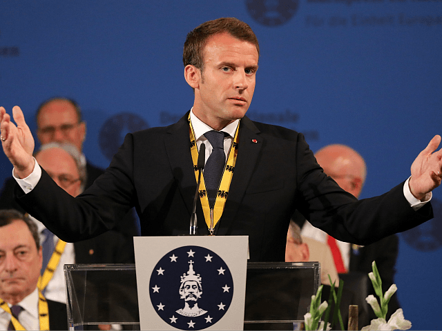 France's President Emmanuel Macron gives a speech after receiving the Charlemagne prize during the award ceremony on May 10, 2018 in Aachen, western Germany. - French President Emmanuel Macron received the prestigious Charlemagne Prize for his 'contagious enthusiasm' for strengthening EU cohesion and integration. (Photo by LUDOVIC MARIN / AFP) …