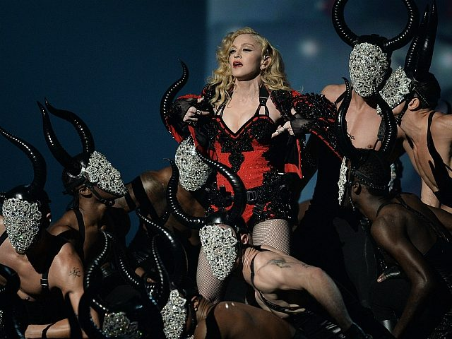 Madonna performs on stage at the 57th Annual Grammy Awards in Los Angeles February 8, 2015. AFP PHOTO/ROBYN BECK (Photo credit should read ROBYN BECK/AFP/Getty Images)