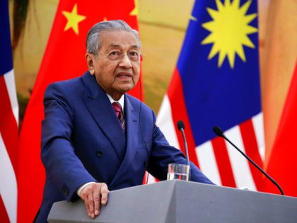 Malaysia's Prime Minister Mahathir Mohamad speaks during a joint press conference with China's Premier Li Keqiang (not pictured) at the Great Hall of the People in Beijing on August 20, 2018. - Mahathir is on a visit to China from August 17 to 21. (Photo by HOW HWEE YOUNG / …