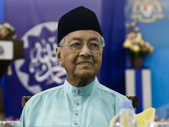 Malaysian Prime Minister Mahathir Mohamad attends an iftar, the fast-breaking event during Ramadan in Kuala Lumpur, Malaysia, Tuesday, May 29, 2018. (AP Photo/Sadiq Asyraf)