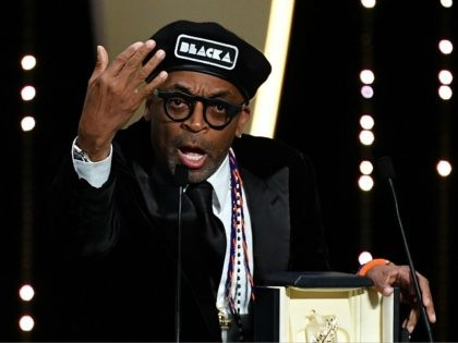 US director Spike Lee delivers a speech on stage on May 19, 2018 after he was awarded with the Grand Prix for the film 'BlacKkKlansman' during the closing ceremony of the 71st edition of the Cannes Film Festival in Cannes, southern France. (Photo by Alberto PIZZOLI / AFP) (Photo credit …