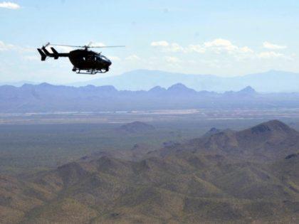 National Guard Lakota LUH-72 helicopter patrols over Arizona mountains (National Guard File Phot-Staff Sgt Scott Tynes)