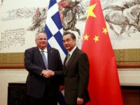 Greece's Foreign Minister Nikos Kotzias (L) is greeted by his Chinese counterpart Wang Yi during their meeting at the Diaoyutai State House in Beijing on August 27, 2018. (Photo by HOW HWEE YOUNG / POOL / AFP) (Photo credit should read HOW HWEE YOUNG/AFP/Getty Images)