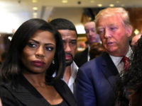 Omarosa Manigault (L) who was a contestant on the first season of Donald Trump's 'The Apprentice' and is now an ordained minister, appears alongside Republican presidential hopeful Donald Trump during a press conference November 30, 2015 that followed Trump's meeting with African-American religious leaders in New York. AFP PHOTO / …