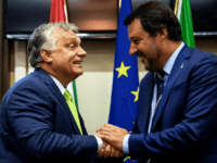 Italy's Interior Minister Matteo Salvini (R) shakes hands with Hungary's Prime Minister Viktor Orban at a press conference following a meeting in Milan on August 28, 2018. (Photo by MARCO BERTORELLO / AFP) (Photo credit should read MARCO BERTORELLO/AFP/Getty Images)