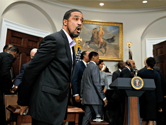Pastor Darrell Scott reacts as reporters ask President Donald Trump question during an event to honor Dr. Martin Luther King Jr., in the Roosevelt Room of the White House, Friday, Jan. 12, 2018, in Washington.