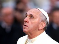 Pope Francis prays to god