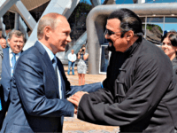 Russian President Vladimir Putin, left, and U.S. actor Steven Seagal shake hands after visiting an oceanarium built on Russky Island, where the Eastern Economic Forum takes place, in Russian Far Eastern port of Vladivostok, Russia, Friday, Sept. 4, 2015.