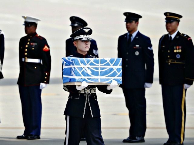 U.N. honor guards carry the boxes containing remains believed to be from American servicemen killed during the 1950-53 Korean War on the arrival from North Korea, at Osan Air Base in Pyeongtaek, South Korea, on July 27, 2018.