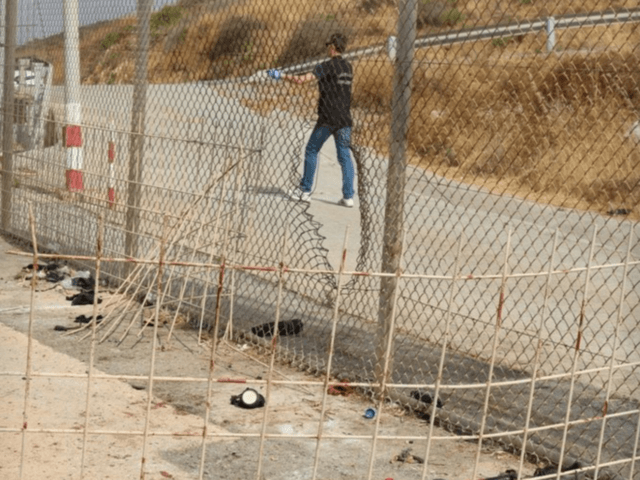 Migrants storm Morocco-Spain border fence, seven police injured