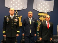 Mr. Tony Dunne and Mr. Tim Nix receive the Secretary of Defense Medal for Valor