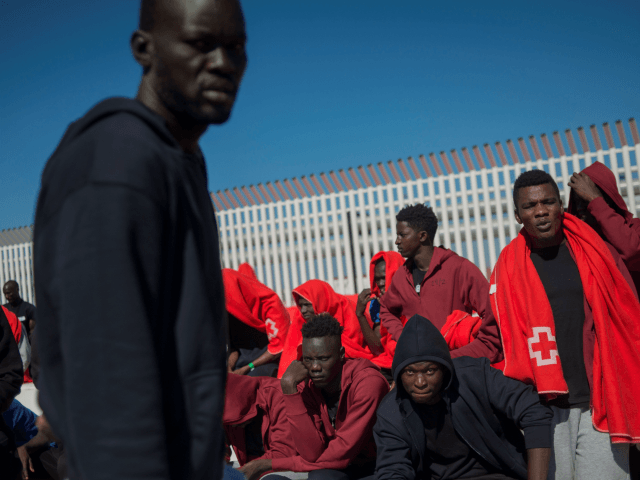 Migrants rescued at sea wait to be transferred at the harbour of Algeciras on July 30, 2018. - Close to 21,000 migrants have arrived in Spain by sea since the beginning of the year and 304 died in the attempt, the International Organization for Migration says. (Photo by JORGE GUERRERO …