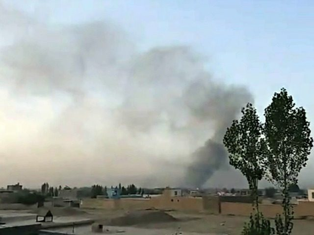 This screen grab taken from AFPTV video on August 10, 2018 shows smoke rising into the air after Taliban militants launched an attack on the Afghan provincial capital Ghazni.