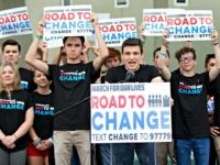 "Cameron Kasky, center, speaks during a news conference, Monday, June 4, 2018, in Parkland, Fla. A day after graduating from high school, a group of Florida school shooting survivors has announced a multistate bus tour to ""get young people educated, registered and motivated to vote."""