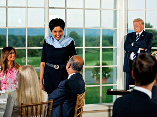 Trump PepsiCo's departing CEO Indra Nooyi, center, stands as she introduces herself during a dinner meeting with President Donald Trump, right, first lady Melania Trump, left, and other business leaders, Tuesday, Aug. 7, 2018, at Trump National Golf Club in Bedminster, N.J.