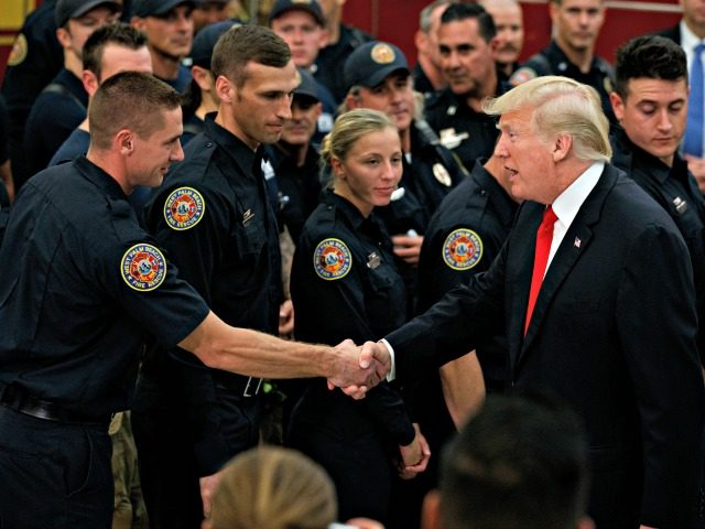 President Donald Trump shakes hands with firefighters at West Palm Beach Fire Rescue, Wednesday, Dec. 27, 2017, in West Palm Beach, Fla. President Trump who is spending the holidays at his private Mar-a-Lago estate and club in Florida thanked them for their service.