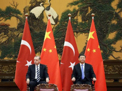 Turkish President Recep Tayyip Erdogan (L) and Chinese President Xi Jinping attend a signing ceremony ahead of the Belt and Road Forum in Beijing on May 13, 2017. / AFP PHOTO / AFP PHOTO AND POOL / JASON LEE (Photo credit should read JASON LEE/AFP/Getty Images)