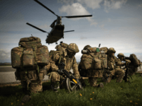STRANRAER, SCOTLAND - APRIL 16: Soldiers from 16 Air Assault Brigade take part in Exercise Joint Warrior at West Freugh Airfield on April 16, 2012 in Starnraer, Scotland. The operation is taking place in South West Scotland between 15-21 April and focuses on a Theatre Entry operation into a notional …