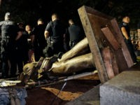 olice stand guard after the confederate statue known as Silent Sam was toppled by protesters on campus at the University of North Carolina in Chapel Hill, N.C., Monday, Aug. 20, 2018. (AP Photo/Gerry Broome)