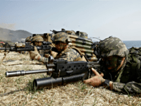 In this March 30, 2015, file photo, marines of South Korea, right, and the U.S aim their weapons near amphibious assault vehicles during U.S.-South Korea joint landing military exercises as part of the annual joint military exercise Foal Eagle between the two countries in Pohang, South Korea. U.S. President Donald …