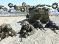 In this March 12, 2016, file photo, Marines of the U.S., left, and South Korea wearing blue headbands on their helmets, take positions after landing on a beach during the joint military combined amphibious exercise, called Ssangyong, part of the Key Resolve and Foal Eagle military exercises, in Pohang, South …