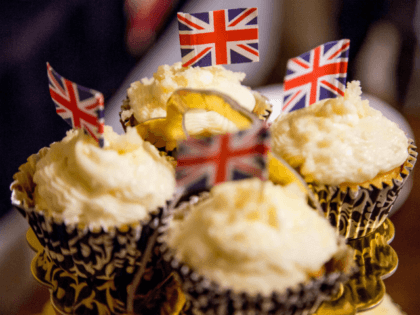 Elderflower cupcakes decorated with the Union Jack are served while a group of women watch the Wedding of Prince Harry and Meghan Markle from the living room of food blogger Veronica Hendrix in Los Angeles, California, on May 19, 2018. (Photo by Kyle Grillot / AFP) (Photo credit should read …