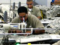 Inmates work on garments at a Federal Prison Industries (UNICOR) facility. The company says it is a ???a life-changing correctional program that has a profound impact on everyone in the community.