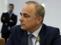 "Israel energy minister Yuval Steinitz is seen during talks with Cyprus' energy minister Yiorgos Lakkotrypis, Greece's energy minister Giorgos Stathakis, and the Italian ambassador in Cyprus Andrea Cvallari, at ""Filoxenia"" conference center in capital Nicosia, Cyprus, on Tuesday, Dec. 5, 2017. Israel's energy minister says a potential undersea pipeline carrying …"