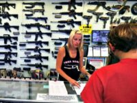 a-gun-store-employee-helps-a-customer-in-colorado
