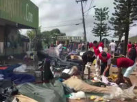 Screen grab taken from a AFP video showing residents of the Brazilian border town of Pacaraima destroying belongings of Venezuelans immigrants during an attack at their two main makeshift camps which led them to cross the border back into their home country on August 18, 2018. - Brazil will send …