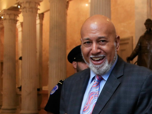 Rep. Alcee Hastings, D-Fla., walks with Tunisian President Youssef Chahed, right, to a House Foreign Affairs Committee meeting on Capitol Hill in Washington, Tuesday, July 11, 2017. (AP Photo/Manuel Balce Ceneta)