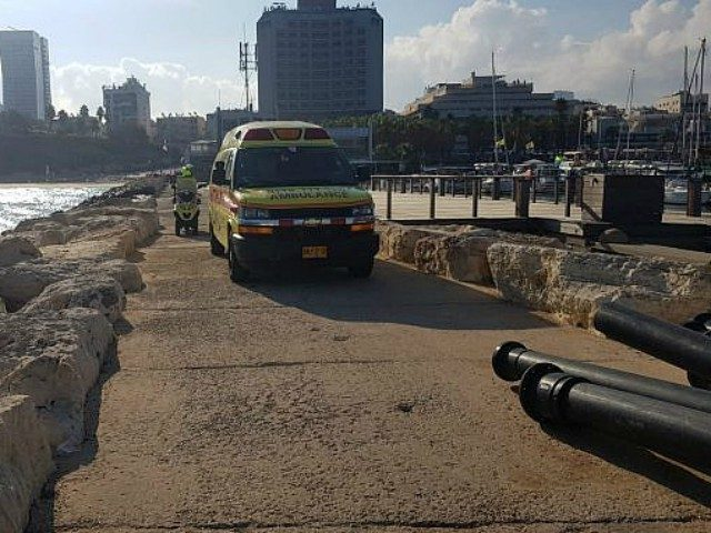 Paramedics on the Tel Aviv waterfront recover a 19-year-old woman's body, July 30, 2018. (Magen David Adom)