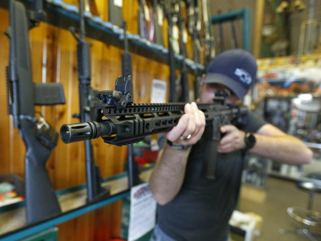 OREM, UT - FEBRUARY 15: Dordon Brack, aims a semi-automatic AR-15 that is for sale at Good Guys Guns & Range on February 15, 2018 in Orem, Utah. An AR-15 was used in the Marjory Stoneman Douglas High School shooting in Parkland, Florida. (Photo by George Frey/Getty Images)