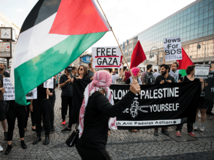 People wave Palestinian flags as they protest in in Berlin on May 14, 2018. - The United States moved its embassy in Israel to Jerusalem after months of global outcry, Palestinian anger and exuberant praise from Israelis over President Donald Trump's decision tossing aside decades of precedent. (Photo by Bernd …