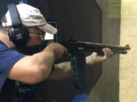 Mossberg 590M, a pump-action 12-gauge shotgun