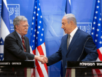 Israeli Prime Minister Benjamin Netanyahu (R) shakes hands with visiting US national security adviser John Bolton during a press conference at the Prime Minister's office in Jerusalem on August 20, 2018. - Bolton arrived in Israel on August 19 for talks with PM Benjamin Netanyahu at a time of shared …