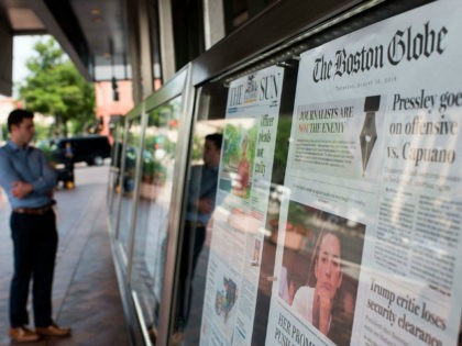 The front page of the Boston Globe August 16, 2018 edition is on display outside the Newseum in Washington DC on August 16,2018. - US newspapers big and small hit back Thursday at Donald Trump's relentless attacks on the news media with a coordinated campaign of editorials, triggering a fresh …