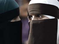 Women wearing niqab to veil their faces take part in a demonstration on August 1, 2018, the first day of the implementation of the Danish face veil ban, in Copenhagen, Denmark. - Denmark's controversial ban on the Islamic full-face veil in public spaces came into force as women protested the …