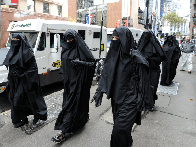 Men and women dressed in burqas from the group 'Faceless' call for the banning of the conservative Muslim apparel throughout Australia during a rally in Sydney on April 2, 2012. The group says the complete covering of a woman's face leads to cultural isolation within multi-cultural Australia and can be …