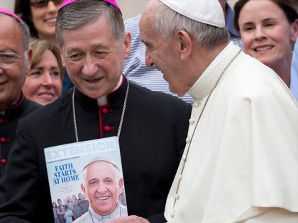Pope Francis salutes Chicago Archbishop Blase Joseph Cupich at the end of his weekly general audience in St. Peter's Square at the Vatican, Wednesday, Sept. 2, 2015. (AP Photo/Alessandra Tarantino)